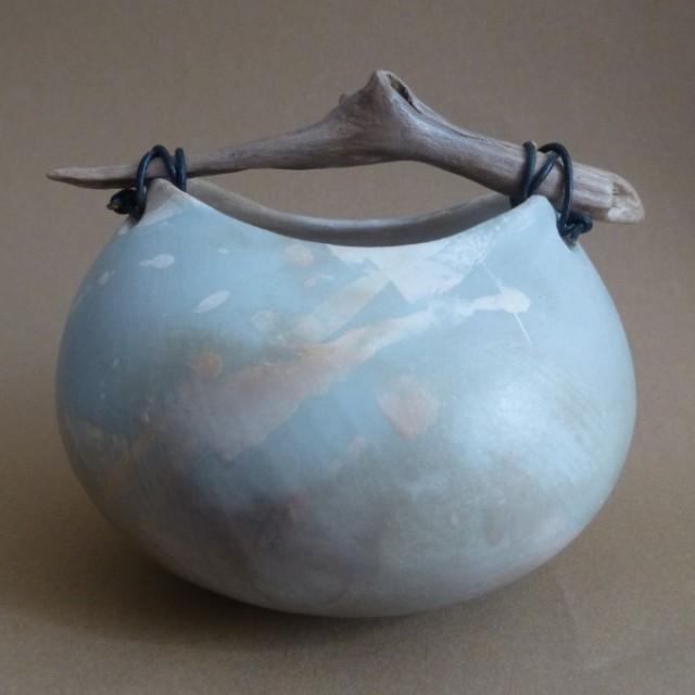 Blue splash pot with driftwood