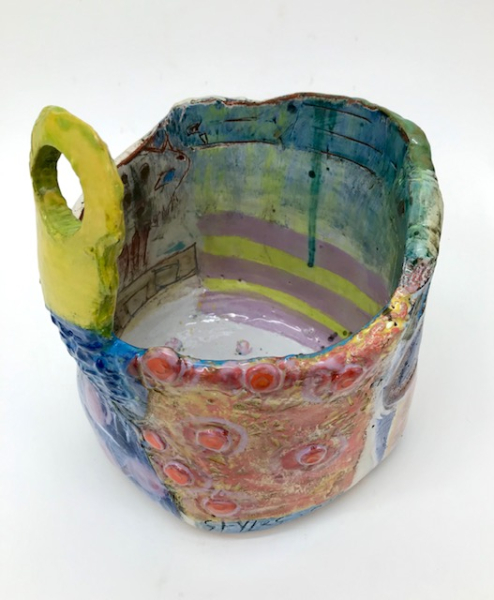 Jug with pink chicklets to interior, tin glaze base with troika-influenced owl and floating boats with yellow hole handle