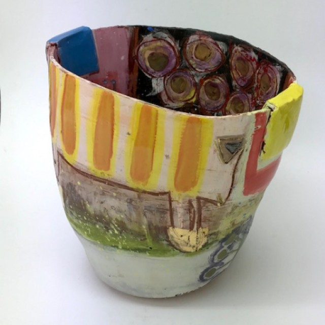 Baggy shaped bucket pot with bright focal colours and flattened oblong lugs