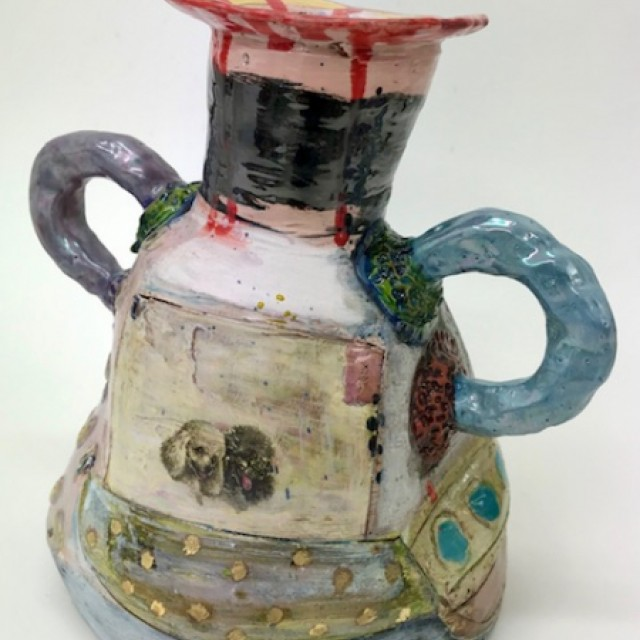 Looped handled narrow necked pot with lustered feature