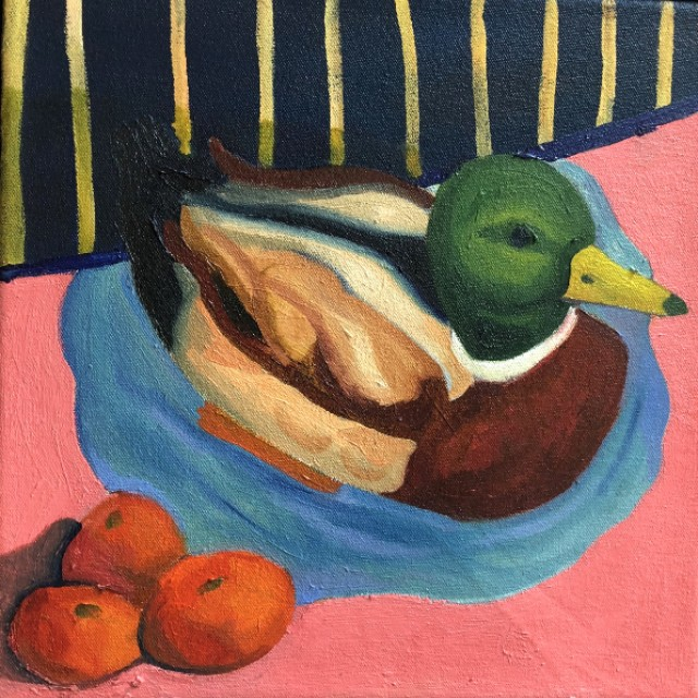 A duck in a puddle dreams of being a tangerine