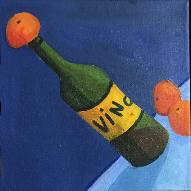 Three bottles of vino and a tangerine