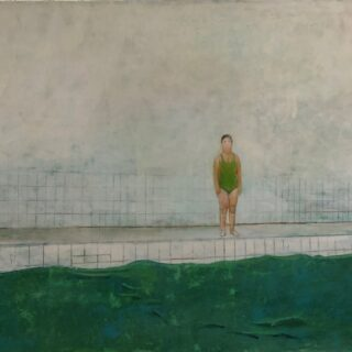 Figure by a pool dressed in green