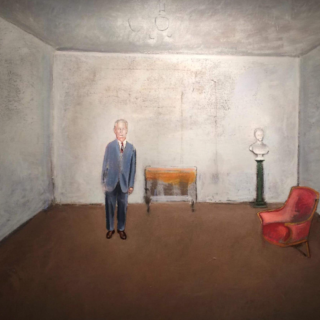 Figure in a grey room with a pink chair