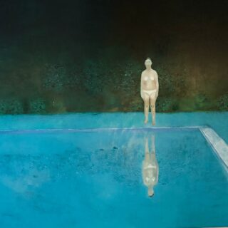 Figure beside a swimming pool with a dark background