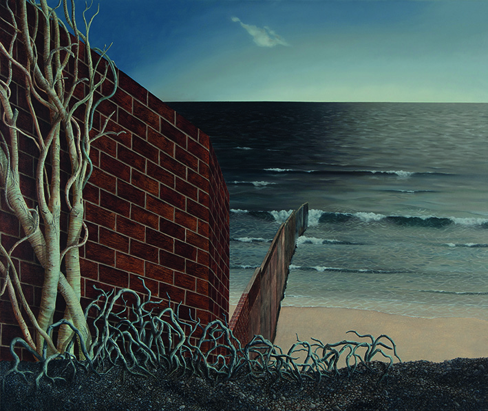 Large brick wall leading down to a beach and sea with a tree on the left hand side.